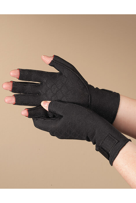 Thermoskin Half Finger Arthritis Gloves Surround aching hands with clinically proven heat therapy. Arthritis-soothing gloves help retain body heat to temporarily relieve pain and stiff joints, with light compression to promote circulation and alleviate swelling. With a half-finger design for freedom of movement, breathable lining, adjustable wrist strap and non-irritating exterior seams, you can count on all-day comfort and support. Small, medium, large. Nylon shell with Trioxon lining. Clinically proven heat therapy.Arthritis-soothing gloves.Temporarily relieves pain and stiff joints.Light compression promotes circulation and alleviates swelling.Half-finger design for freedom of movement.Breathable lining.Adjustable wrist strap.Non-irritating exterior seams.Small, medium, large.Nylon shell with Trioxon lining.
